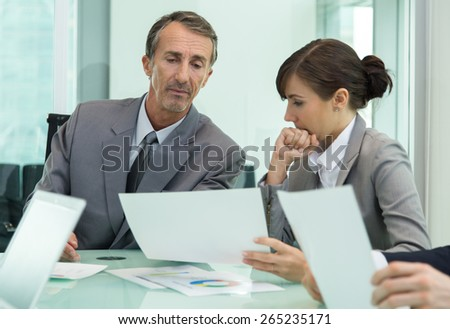 Business meeting and discussion - stock photo