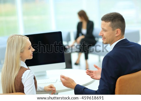 Business meeting at the table with computer