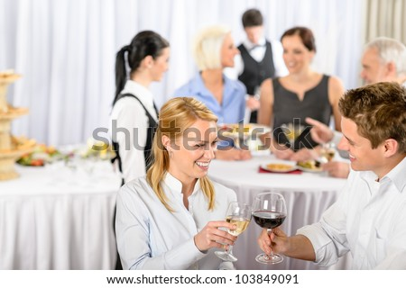 Business meeting banquet man and woman celebrate wine partnership cooperation - stock photo
