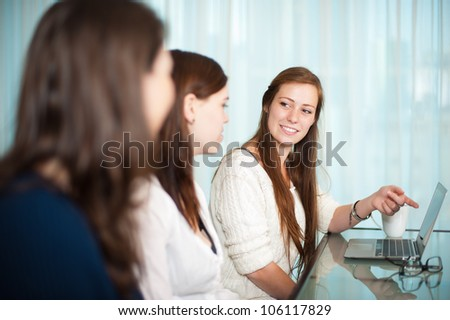 Business meeting between ladies with a laptop on the table. - stock photo
