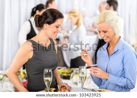 Business meeting buffet smiling woman eat dessert formal company event - stock photo