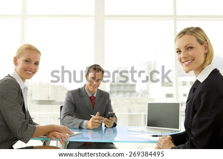 Business meeting. Businessman with two businesswomen. - stock photo