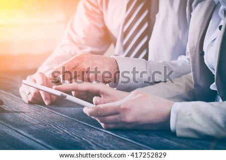 business meeting executive consulting review career report tablet - stock image