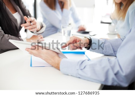 Business meeting. Group of business people working with digital tablet. - stock photo