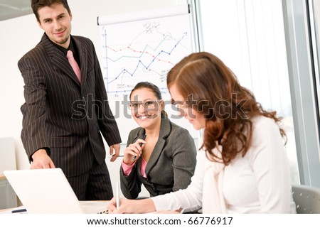 Business meeting - group of people in office at presentation - stock photo