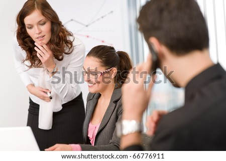 Business meeting - group of people in office sitting at laptop - stock photo