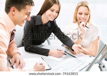 Business meeting - Happy businesspeople talking - stock photo