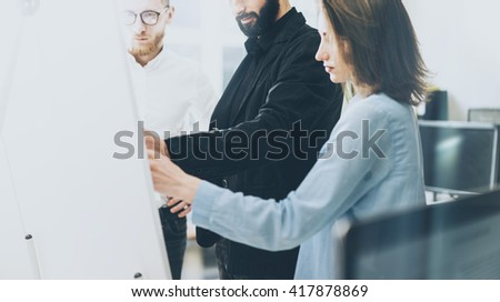 Business meeting image.Photo man drawing statistic info chart board.Photo creative department working with new startup project. Idea presentation,analyze plan,brainstorming.Film effects.Horizontal