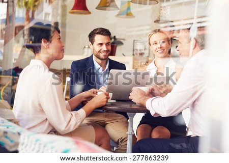 Business meeting in a cafe - stock photo