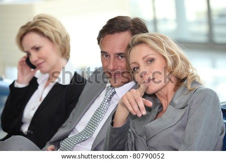 Business meeting in airport - stock photo