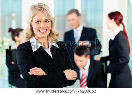 business meeting in an office a colleague is looking into the camera business nap office relieve