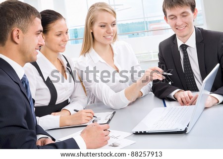 Business meeting in an office with businessmen and businesswomen - stock photo