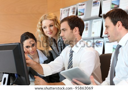 Business meeting in front of desktop computer - stock photo