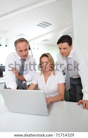 Business meeting in front of laptop computer - stock photo