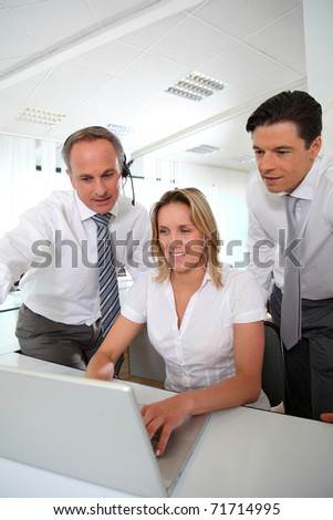 Business meeting in front of laptop computer