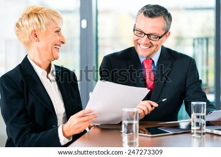 Business - meeting in office, the businesspeople are discussing a document and working on Laptop computer - stock photo