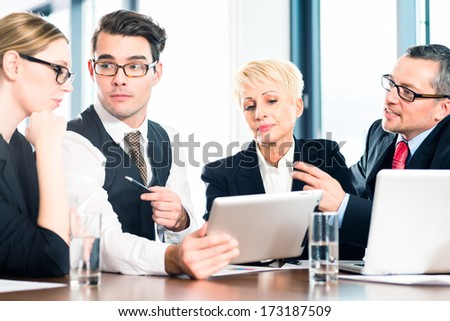 Business - meeting in office, the businesspeople with boss and team are discussing a document on tablet and Laptop computer - stock photo