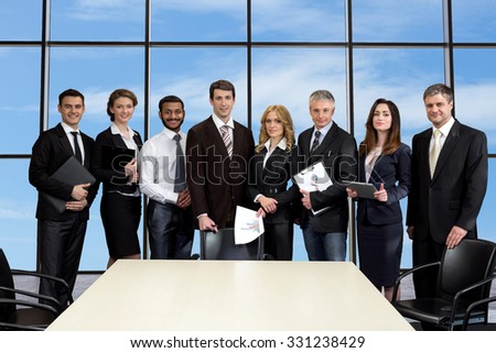 Business meeting in skyscraper. Business colleagues on the background of sky. Managers on the background of window. - stock photo