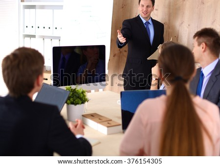 Business meeting -  manager discussing work with his colleagues - stock photo