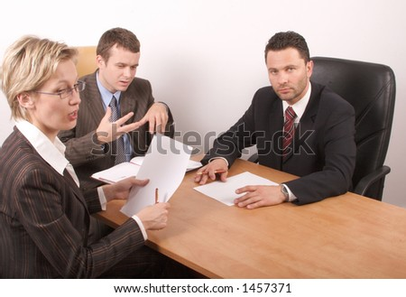 Business meeting - 2 men, 1 woman - stock photo