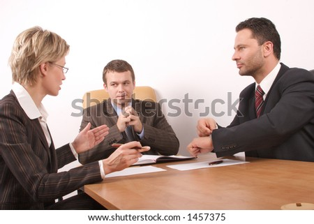 Business meeting - 2 men, 1 woman, - signing contract