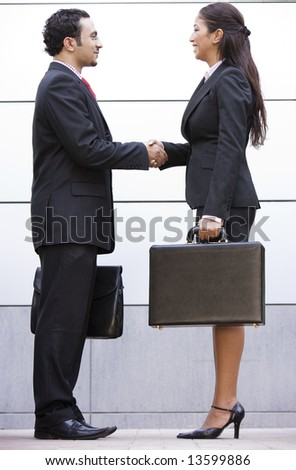 Business meeting outside modern office - stock photo