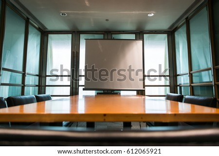 Business meeting room in office with screen projector.