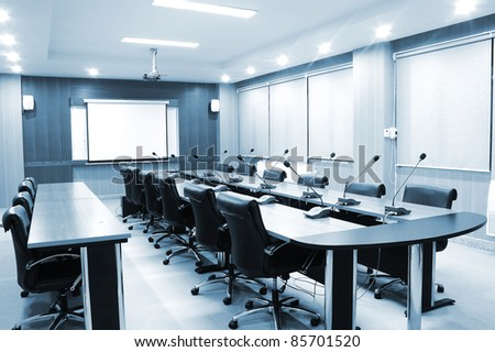 Business meeting room or board room interiors - blue tone - stock photo