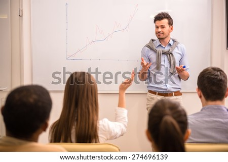 Business meeting. Teamwork concept. Young businessman with speech to colleagues. - stock photo
