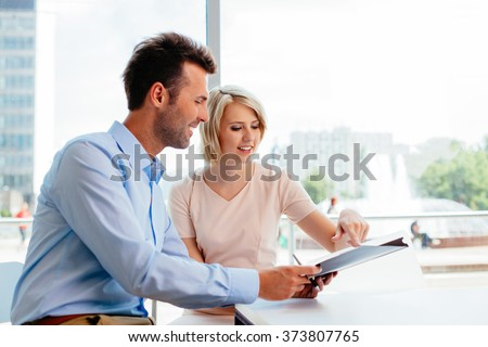 Business meeting. Two professionals signing contract - stock photo