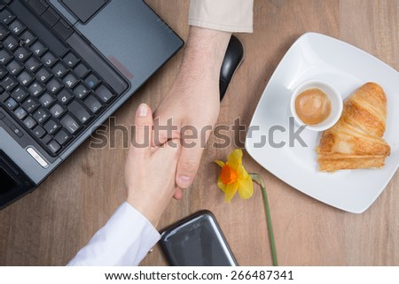 business meeting with coffee and croissant - stock photo