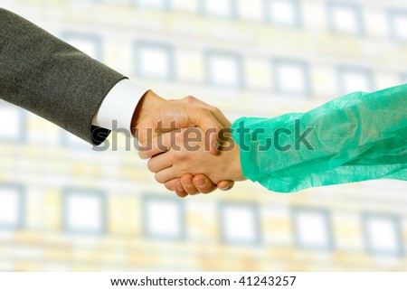 Business men and doctor hand shake, close up - stock photo