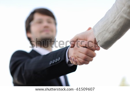 Business men and women shaking hands on a light background. Meeting. - stock photo