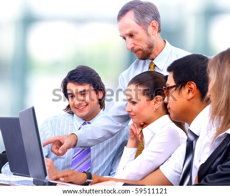 Business men and women working on blue prints - stock photo