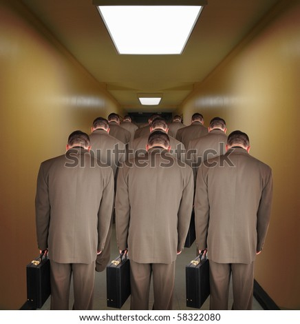 Business men are walking down a hallway to do office work. The heads are down to symbolize pressure or powerlessness from the job. Use it for an unemployment or a career concept. - stock photo
