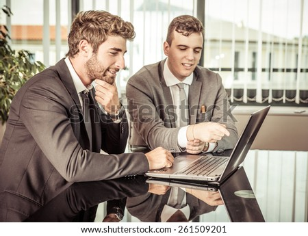 business men at work. concept about team work, finance and business. two employer working in team for a successful business plan - stock photo