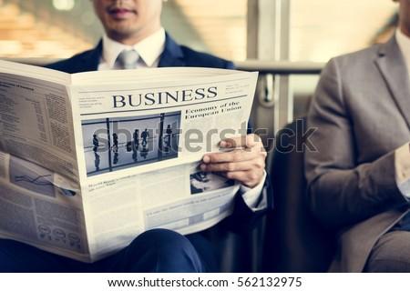 business men break sit read newspaper stock photo 570316480 shutterstock. Black Bedroom Furniture Sets. Home Design Ideas
