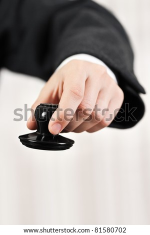 Business men hand holding office paper document stamp - stock photo