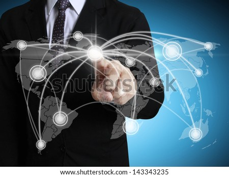 Business men hand pushing social network structure - stock photo