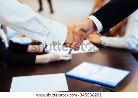 Business men hand shake - stock photo