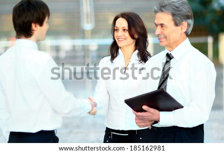 Business men hand shake in the office  - stock photo