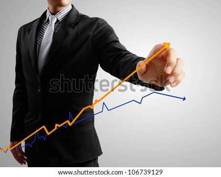 Business men hand write graph - stock photo