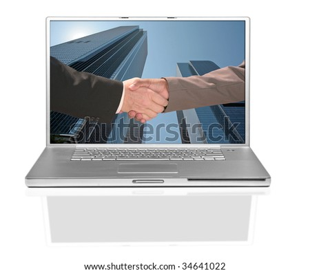 Business Men Handshake on a Computer Screen Against Building Background - stock photo