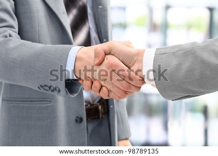 Business men in a handshake at the office - stock photo