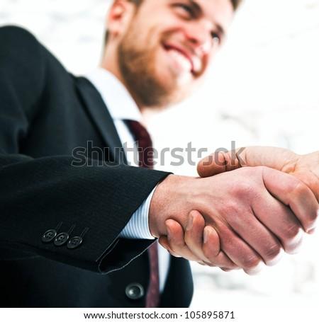 Business men shaking hands - stock photo