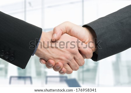 Business men shaking hands - stock photo