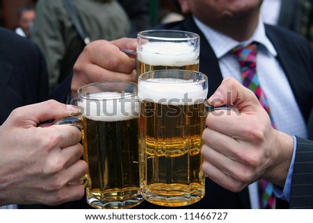business men toasting with their beers - stock photo