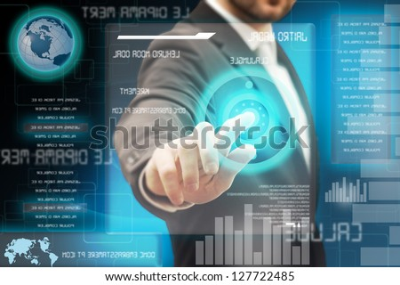 Business men touching a futuristic touchscreen interface - stock photo