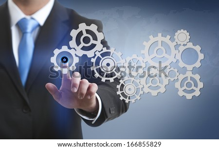 Business men touching a futuristic touchscreen interface - technology concept  - stock photo