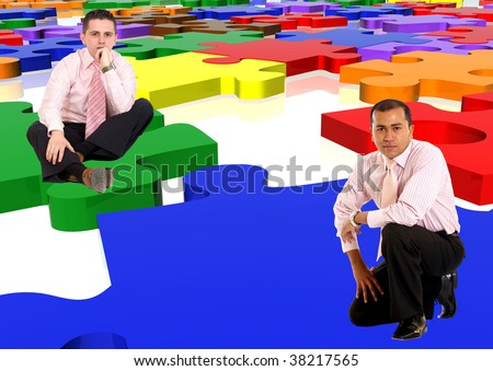Business men with a multicolour puzzle isolated